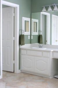 Bathroom with white cabinets and trim